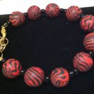 Black & Red animal print polymer clay bracelet