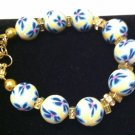 Yellow polymer clay w a light & dark blue floral bracelet