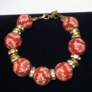 Red Clay surrounds beautiful floral designs bracelet