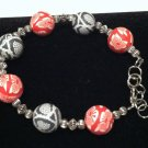 2 cane style polymer clay beads are used in this bracelet