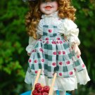Doll with fruit cart