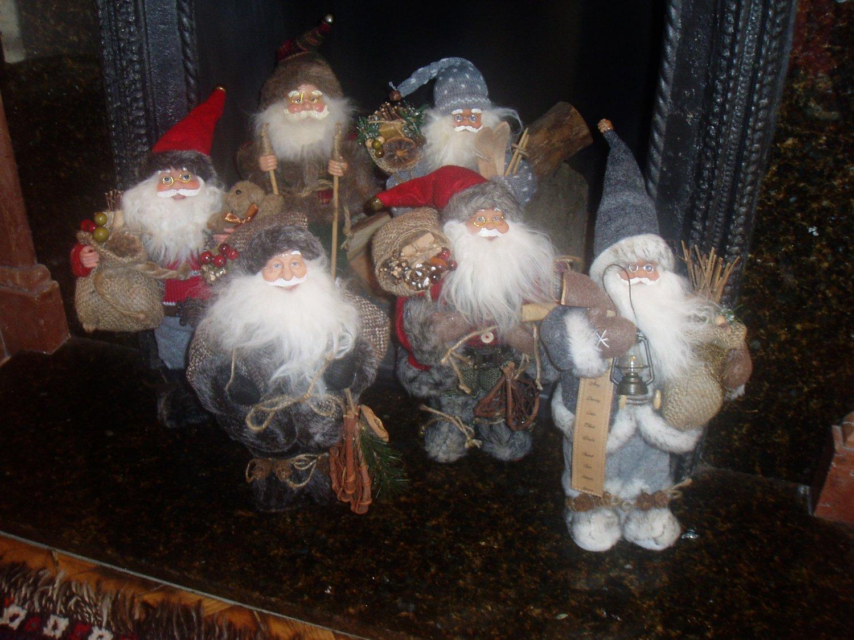 group of father christmas figures