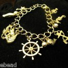 Nautical Beach Charm Bracelet Goldtone Anchor Sea Horse Wheel Fish Pearls Shell