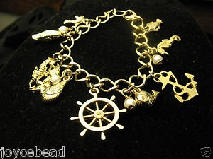 Nautical Beach Charm Bracelet Goldtone Anchor Sea Horse Wheel Fish Pearls Shell