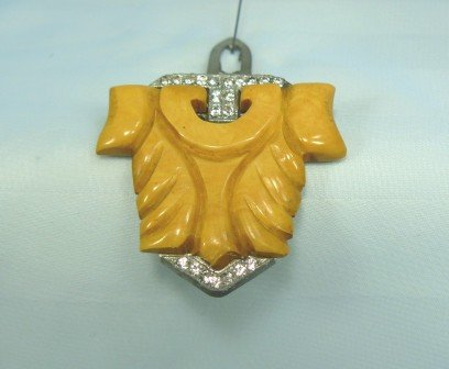 *Vintage Bakelite Dress Clip:  Carved Design Done in Butterscotch Trimmed with Rhinestones