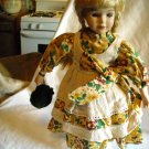 """Porcelain Doll with Stand in Flowered Dress Golden Hair 15"""" Tall"""