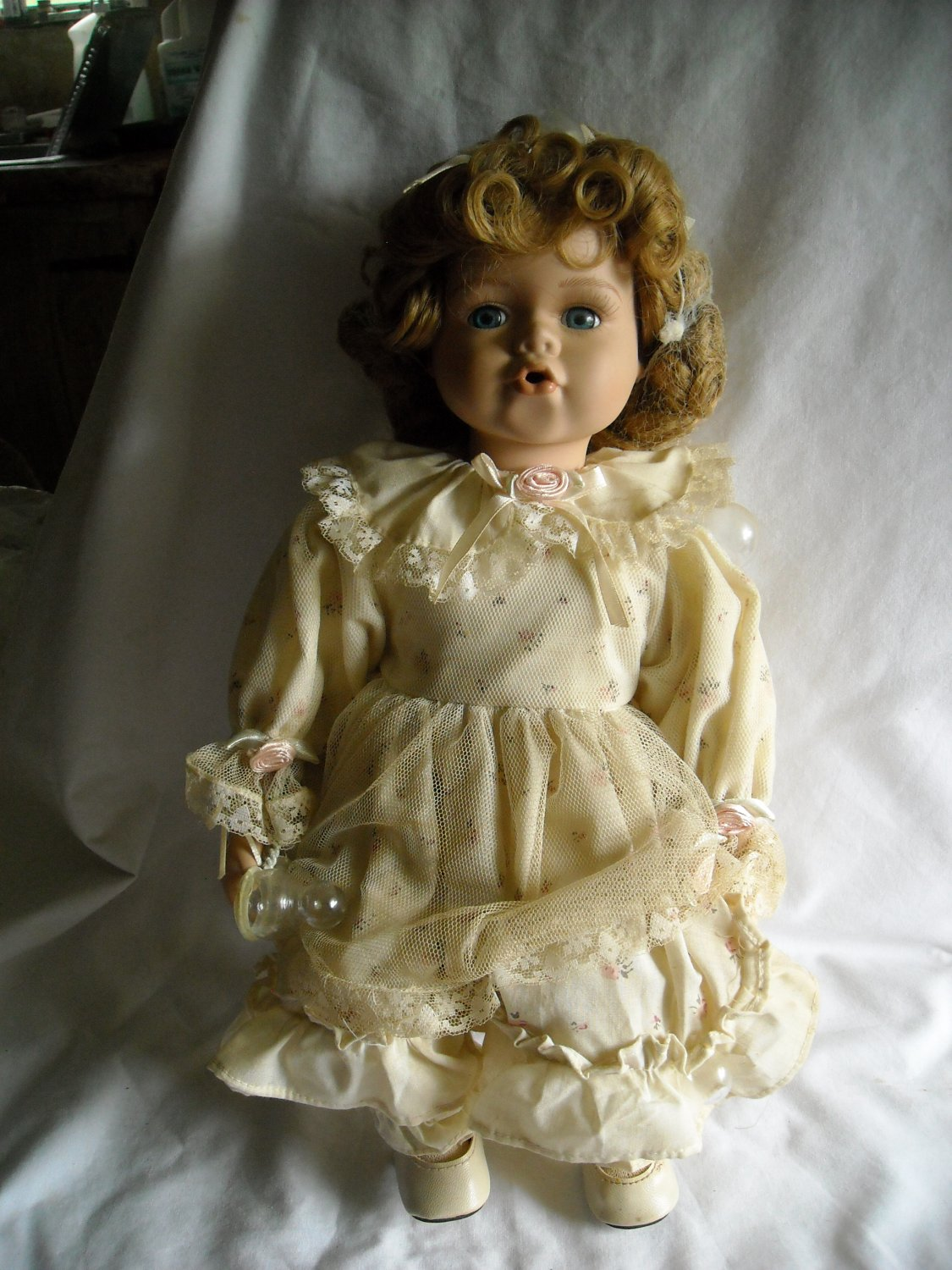 bubble baby porcelain doll with white wooden stool 14 tall