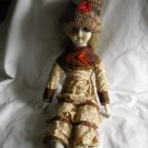 Porcelain Doll In Brown Flowered Outfit