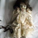 Porcelain Doll In White Flowered Outfit