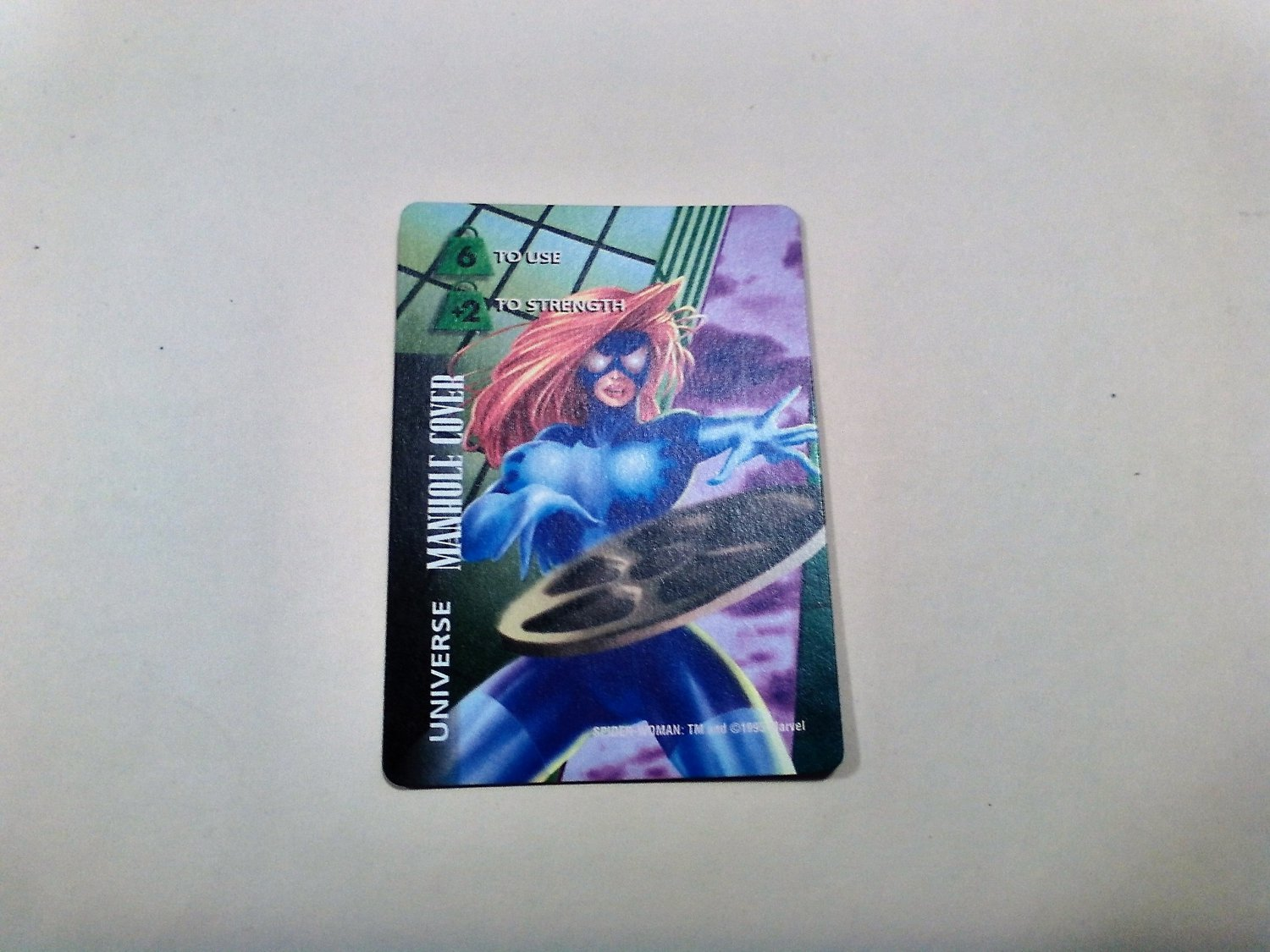 Marvel OverPower - Spider-Woman Manhole Cover No. 324 Common, Universe Card (1995) Fleer