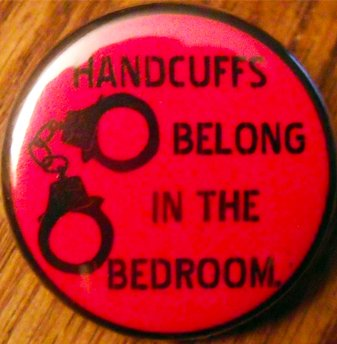 HANDCUFFS BELONG IN THE BEDROOM pinback button badge 1.25""