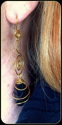 Hand Wired Gold with Black Caged Bead
