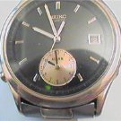 black dial seiko alarm date quartz watch runs 4u2ix