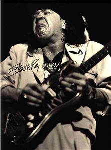 STEVIE RAY VAUGHAN SIGNED PHOTO 8X10 RP AUTOGRAPHED VAUGHN