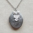 FLORAL LOCKET & SILVER OWL CHARM NECKLACE