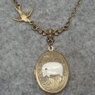 Handmade ELEPHANT AND BIRD : OVAL LOCKET SHELL ELEPHANT SWALLOW BIRD NECKLACE