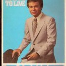 Survival: Unite to Live by Jim Bakker forward by Oral Roberts