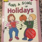 Sing a Song of Holidays (Learn With Piggyback) [paperback] Lustig, Jill,Warren, Jean,Burris