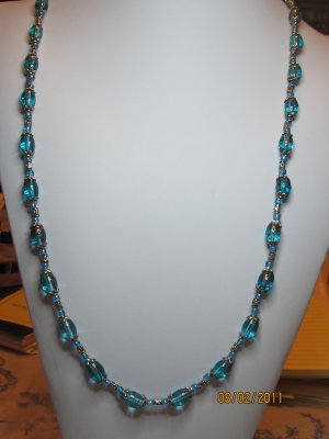 31 Inch Blue Oval Glass Beads Accented With Silvertone Spaces And Bead Tips