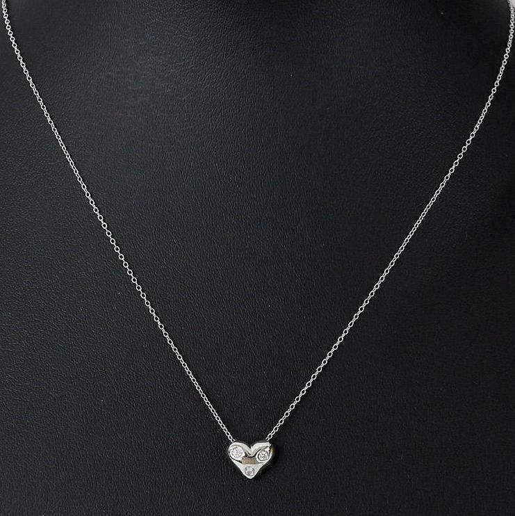 Tiffany co platinum 3 diamond etoile heart pendant necklace aloadofball Image collections