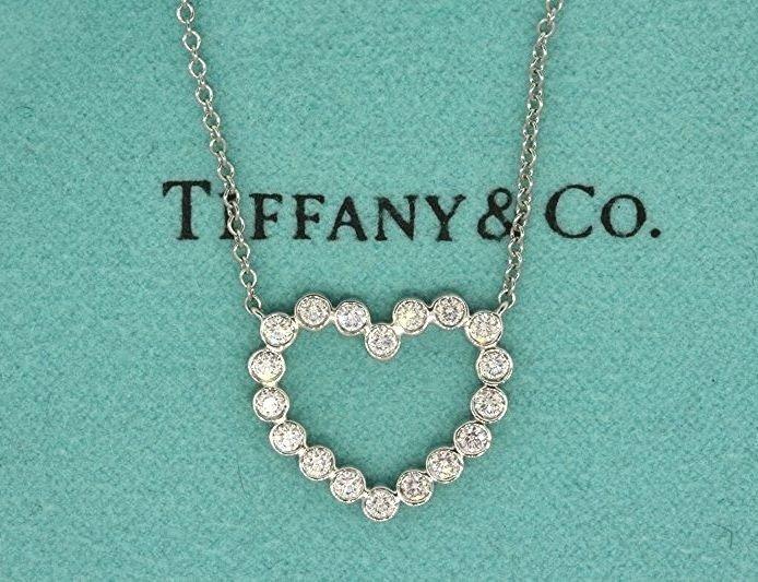 Tiffany co platinum bezel set diamond heart pendant necklace aloadofball Image collections