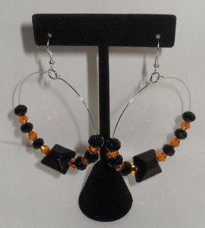 Hoop Earrings with a large black bead and swarovski crystal black and gold beads