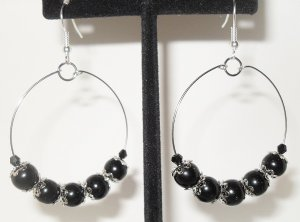 Hoop earrings black beads and silver bead caps on a silver plated hoop