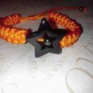 Black Plastic Star Rattail Stain Cord Orange Bracelet