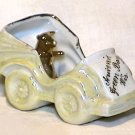 Porcelain Luster Souvenir Automobile Pig in Car
