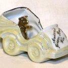 Porcelain Luster Souvenir Automobile Pig in Car