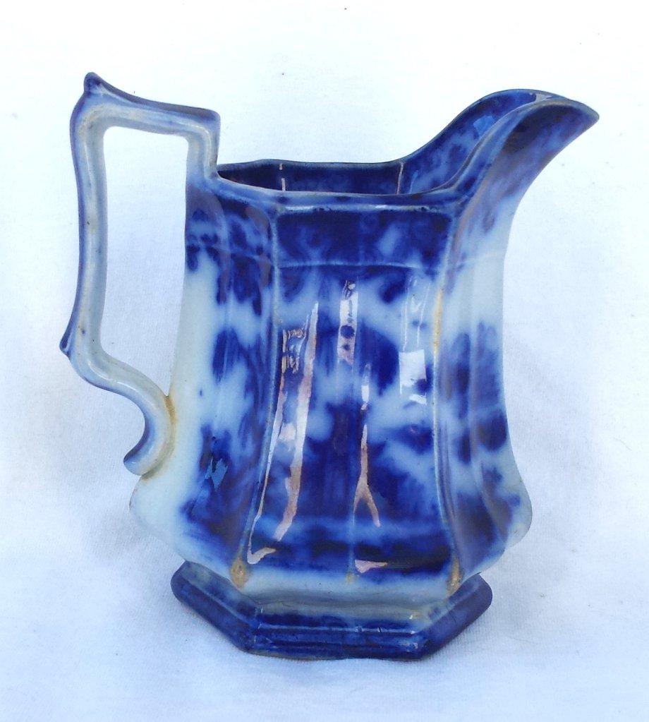 Flow Blue Oriental Theme Pitcher Circa 1860