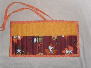 Hand Crafted Snoopy Crayon Holder Roll Up with Orange Tie