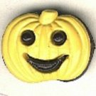 Pumpkin face button..realistic modern snap-together, black and yellow plastic button