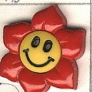 Flower head smiley face button..realistic modern snap-together, red and gold plastic button