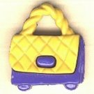Purse button..realistic modern snap-together, blue and gold plastic button