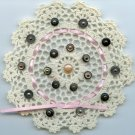Crocheted doily with vintage shoe buttons