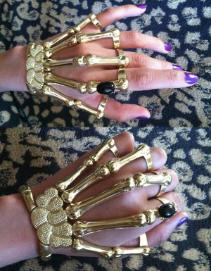 Gold W Black Stone Skeleton Hand Bone