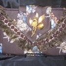 Brown floral Printed Tie Purse with brown lace and trime. Antique gold broach.