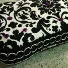 Black and White Damask with purple gems. New Mom must have!