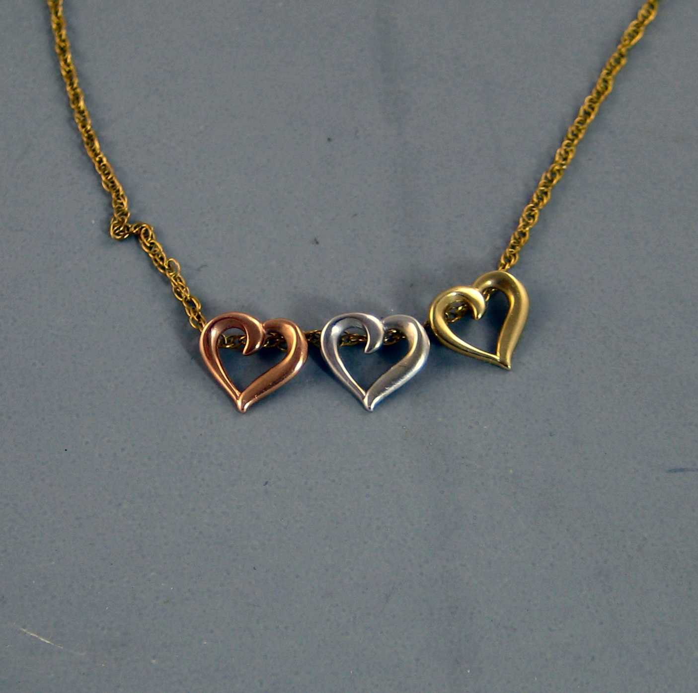 Three Hearts on a Chain Pendant 10K Yellow, White, and Rose Gold