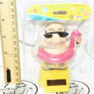 """SOLAR POWER - SWIMMING MAN WITH FLAMINGO FLOAT ON HAND DANCING TOY 3.75"""" FIGURE"""