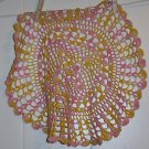 Pink and Yellow Crocheted Doily