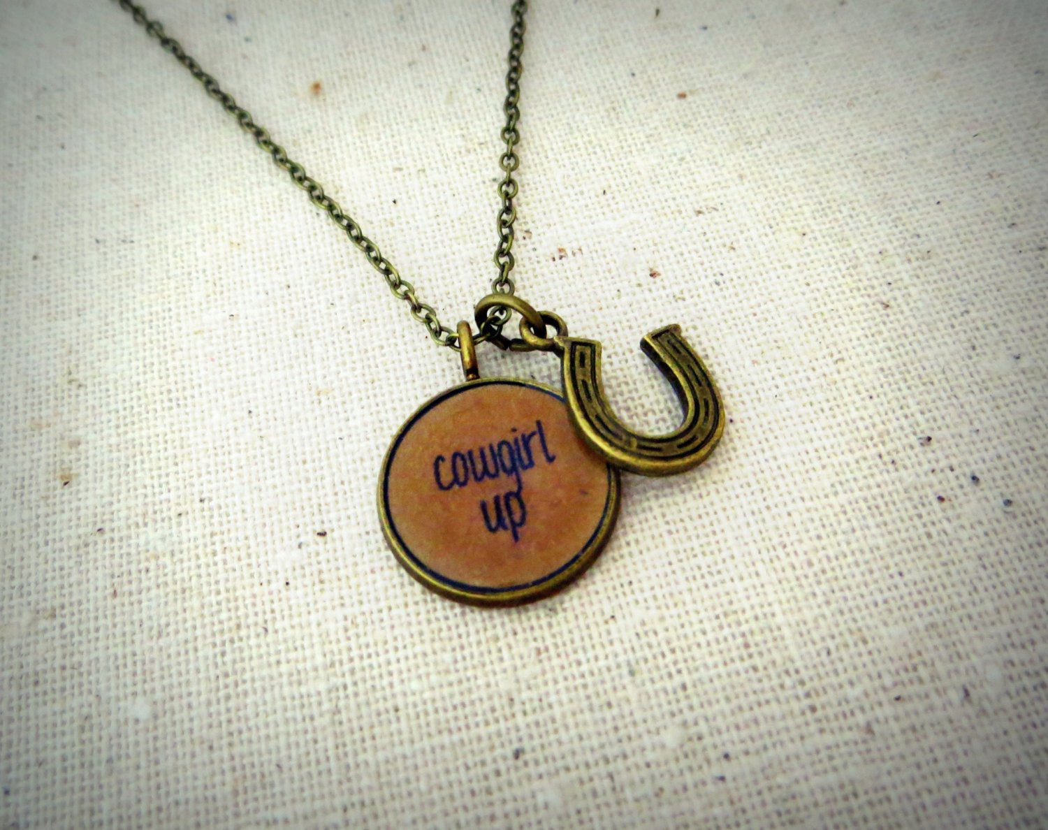 Cowgirl Up Inspirational Quote Pendant Necklace With Horseshoe Charm (Brass)
