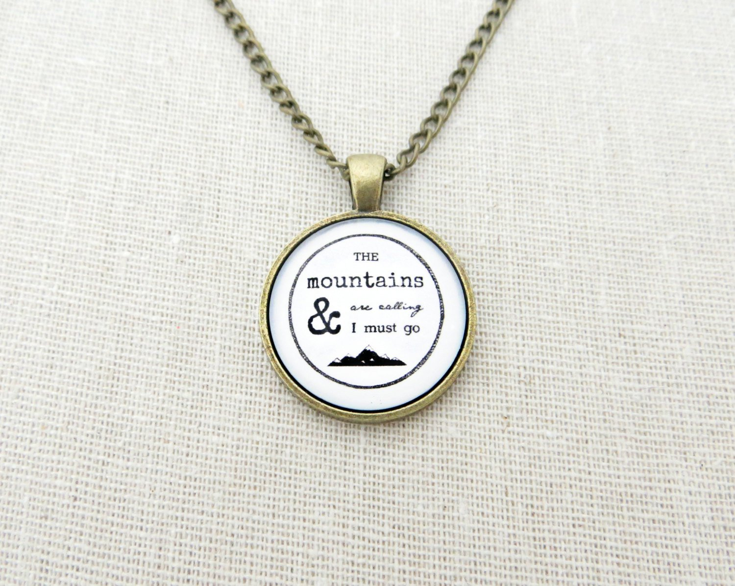 The Mountains Are Calling & I Must Go Inspirational Quote Pendant Necklace (Brass 18 inches)