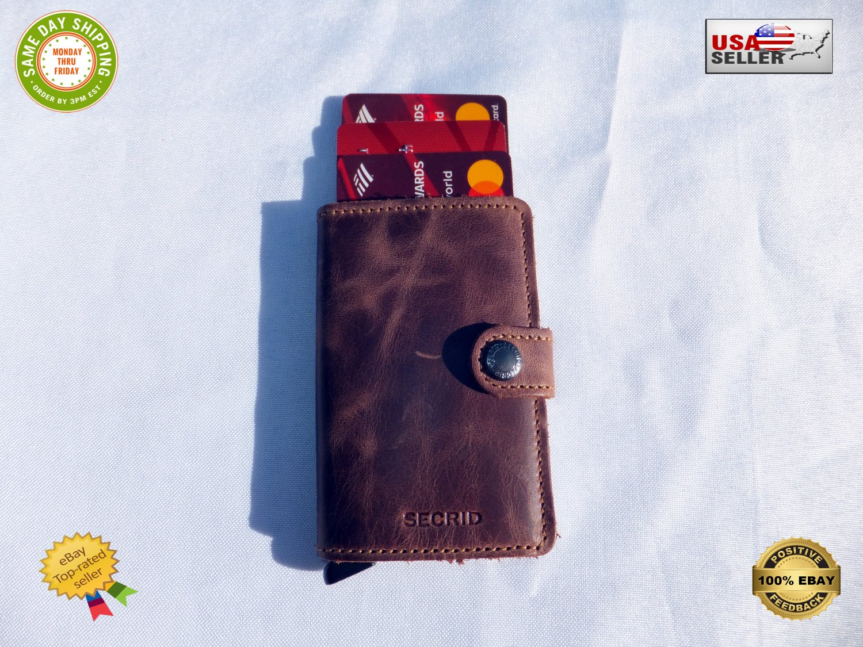 � Secrid Vintage Leather-Bound Gentleman�s Wallet Slim 6 Cards �fan-out� mechanism �
