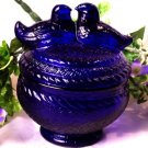 Cobalt Blue Love Birds atop A Jar
