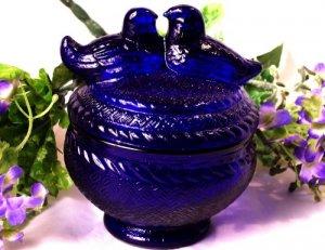 Cobalt Blue Love Birds atop A Jar