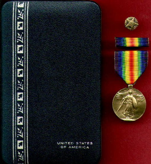 WWI Victory medal with ribbon bar and discharge pin cased set