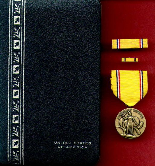 WWII American Defense medal in case with ribbon bar and lp