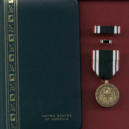 Prisoner of War medal in case with ribbon bar and lapel pin